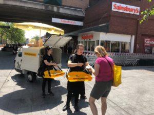 Consumer tries product sample sin Sainsbury's supermarket