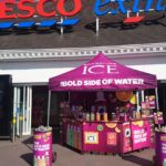 Product sampling in tesco supermarket with water brand