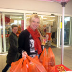 Shopper buying product after sampling in sainsbury's supermarket